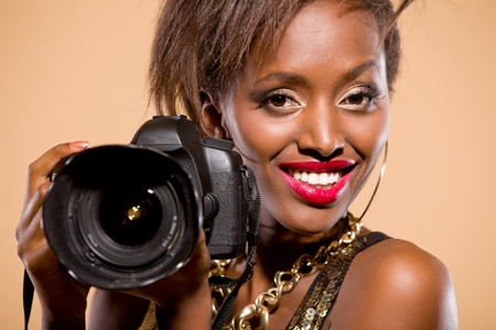 African american model holding DSLR camera photo