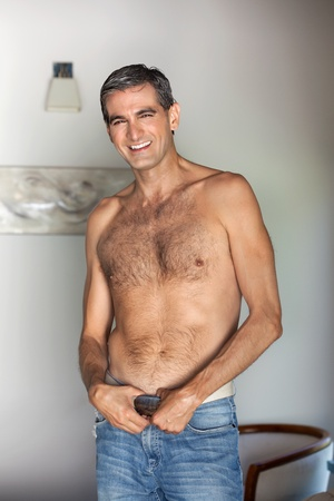 40s: Portrait of handsome shirtless middle aged man smiling Stock Photo