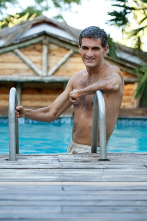 Portrait of handsome middle aged man standing in the swimming pool Stock Photo - 11538727