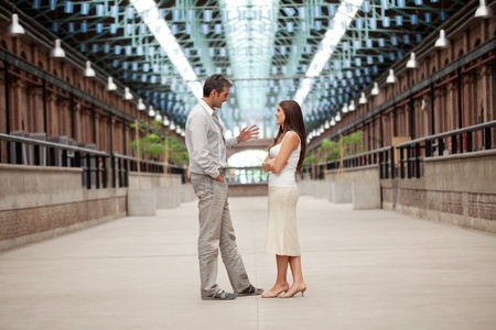 Full length of handsome man talking to beautiful woman Stock Photo - 11538637