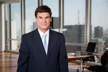 man in suite: Portrait of smart well-dressed male entrepreneur smiling