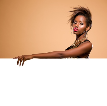 Attractive black woman model standing behind large white banner photo
