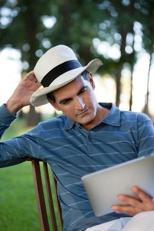 ereader: Casual middle aged man looking at tablet PC screen