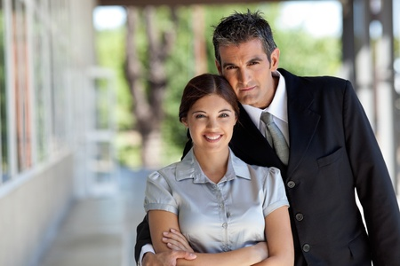 Portrait of professional business couple smiling photo