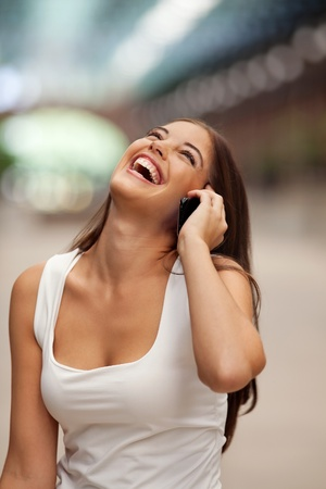 calling communication: Beautiful cheerful young woman talking on phone