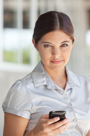 Portrait of an attractive businesswoman holding cell phone photo