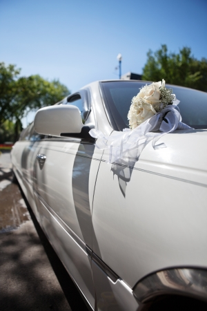 Luxury wedding car with rose flower bouquet