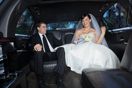 Newlywed in a luxury wedding limousine photo