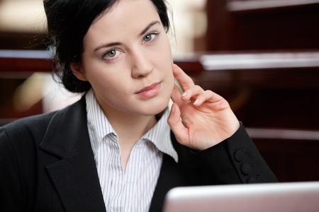 Portrait of smart confident business woman photo