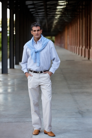 Full length of smart middle aged man standing with hands in pocket Stock Photo