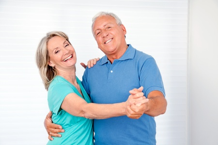 Portrait of elderly couple enjoying dance together photo