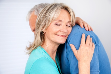 Wife embracing her husband with eyes closed Stock Photo - 11702345