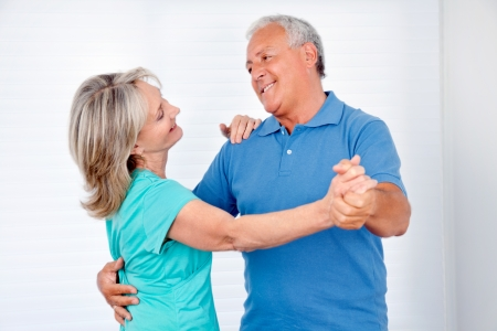 Happy couple enjoying dance together at home photo