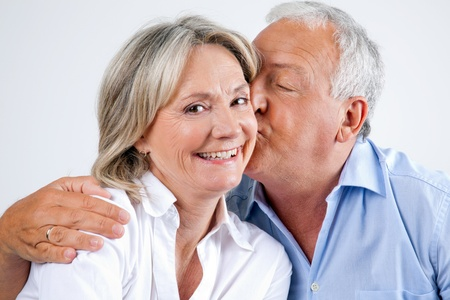 Close-up portrait of woman being affectionately kissed by her husband Stock Photo - 11702394