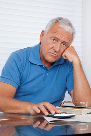 old man sitting: Portrait of senior man upset with financial budget
