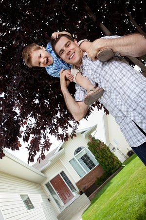 Son on his father's shoulders having fun Stock Photo - 11702417