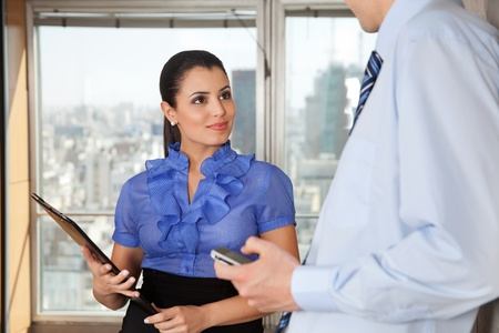 Two business executives standing together in office Stock Photo - 11702436