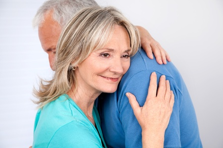 Woman embracing her husband with smile photo