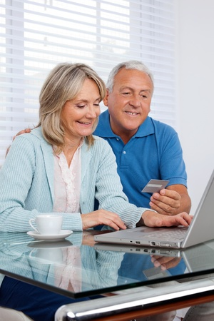 Senior couple making online purchases photo