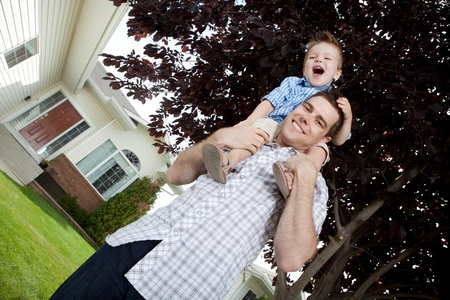 Portrait Of Cute Little Boy Sitting On Father's Shoulder. photo