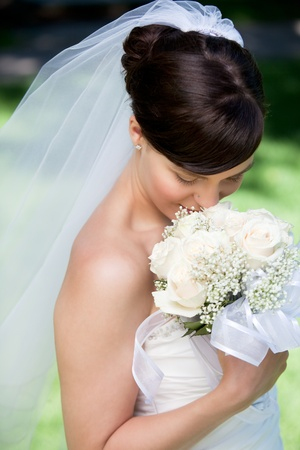 Portrait Of Young Happy Bride With Flower Bouquet. photo
