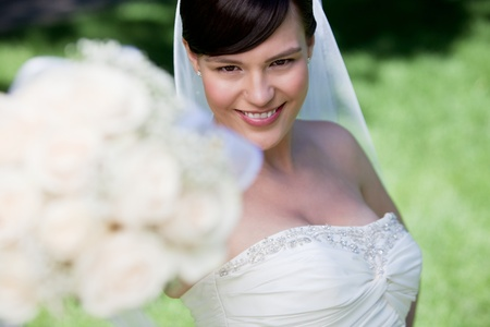 Attractive Bride Showing Off Her Flower Bouquet. photo