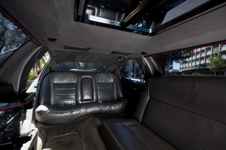 Detail shot of a limousine interior with black leather