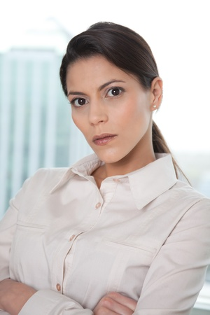 Portrait Of Young Business Woman With Arms Crossed . photo