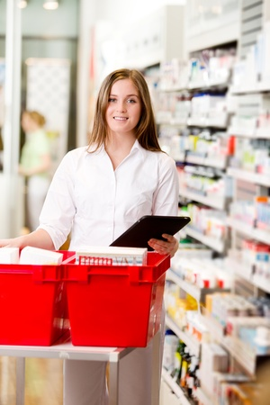 Pharmacist filling a prescription from a digital tablet photo
