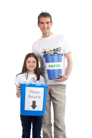Portrait of happy father and daughter holding recycle bin  photo