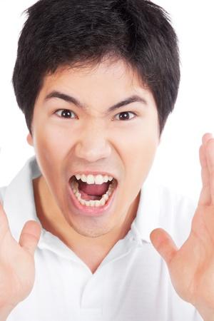 complaining: Young asian man yelling isolated on white background  Stock Photo