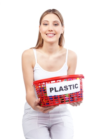 Happy young woman holding red basket in hand  Stock Photo - 12767197