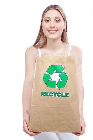 woman holding paper recycling bag photo