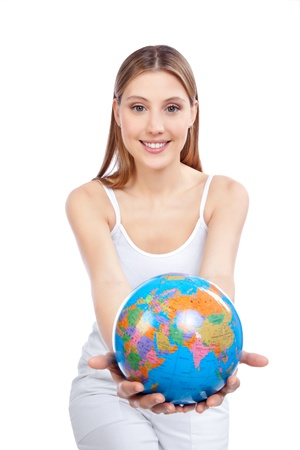 Young happy woman holding  globe in hand  photo