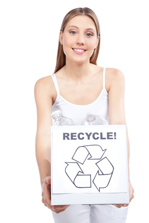 Young happy woman holding recycling waste box  photo