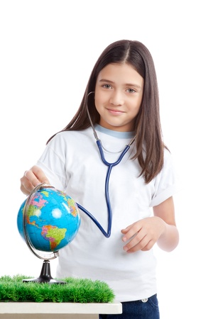 dedication: Happy girl with stethoscope and globe  Stock Photo