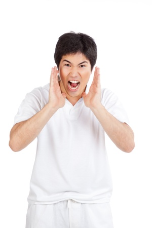 Young asian man yelling isolated on white background  Stock Photo - 12767144