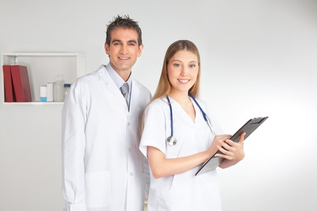 Portrait of happy smiling female and male doctor Stock Photo - 12767248