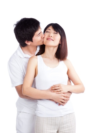 Portrait of man kissing woman on cheek isolated on white background  photo