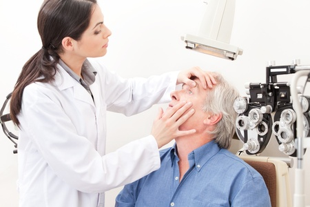 doctor of optometry: Optometrist taking an eyesight test examination  Stock Photo
