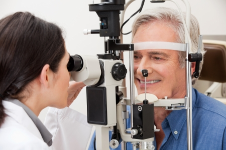 ophthalmologist: Optometrist performing visual field test
