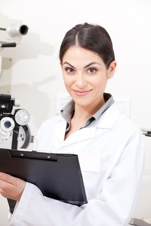 Portrait of female optometrist in clinic  Stock Photo - 13263971
