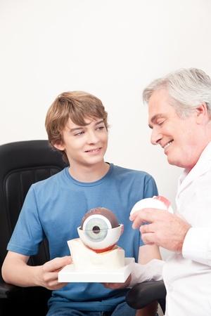 Optometrist showing medical eye model  photo