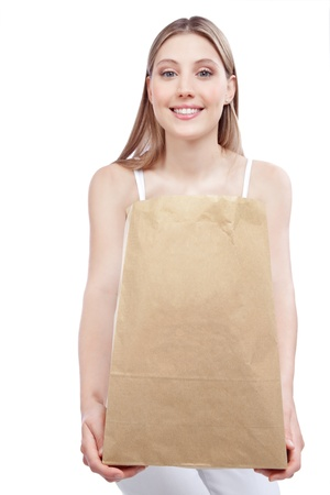 recycle bag: Young happy woman holding shopping paper bag  Stock Photo