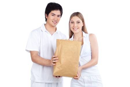Portrait of young happy couple holding paper bag  photo