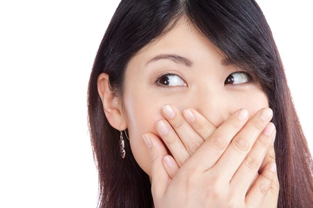 Surprised asian woman covering her mouth by the hands isolated on white background  photo