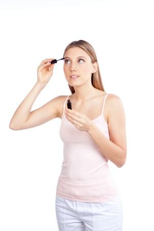 Beautiful woman applying mascara on her eyelashes Stock Photo - 13263719