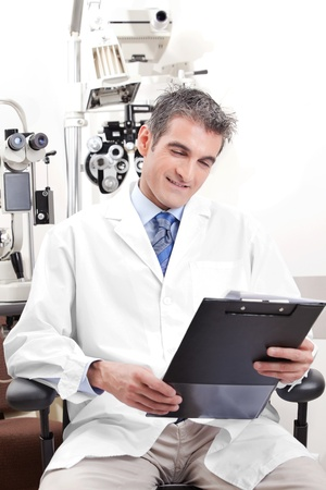 medical attendance: Portrait of doctor in ophthalmology clinic