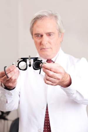 Optometrist holding a eye test glasses  Stock Photo - 13263782