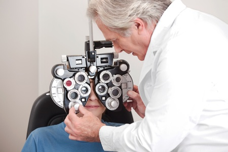 ophthalmology: Optometrist doing sight testing for pateient